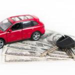 $100 bills with car keys and toy car